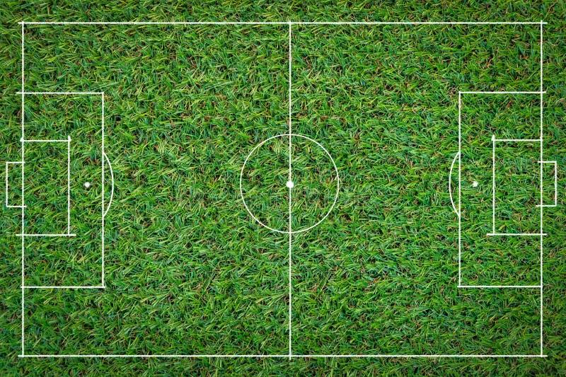 Grünes Gras des Fußballplatzfußballs lizenzfreies stockbild