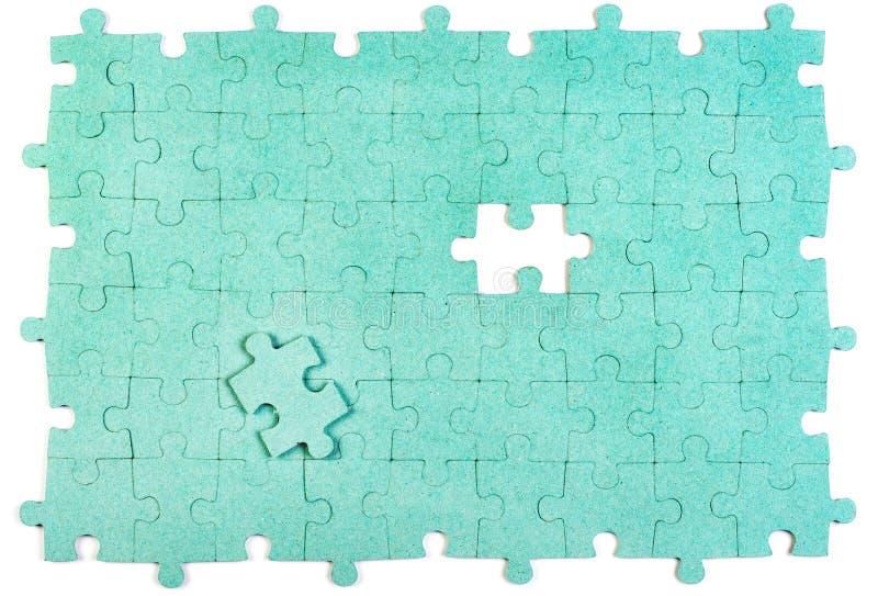 Grünes Puzzlespiel lizenzfreies stockbild