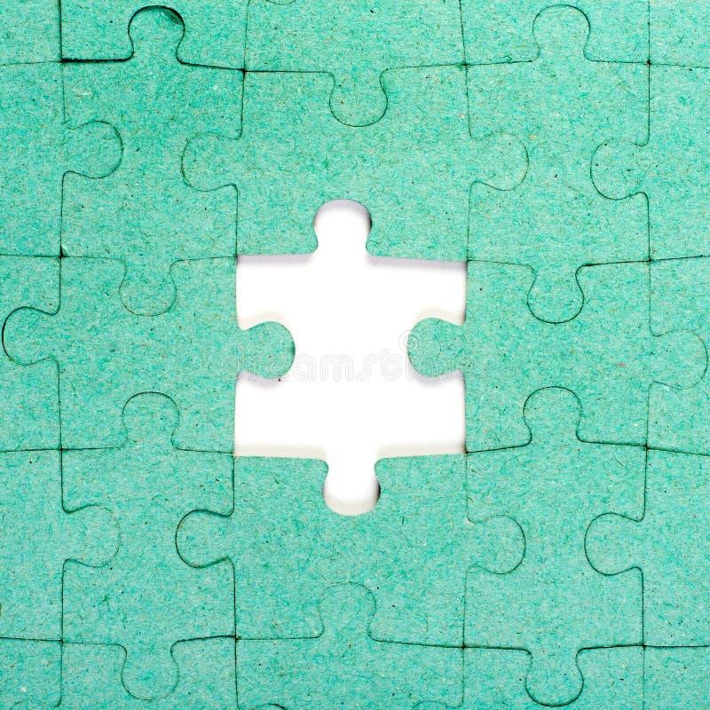Grünes Puzzlespiel stockfoto