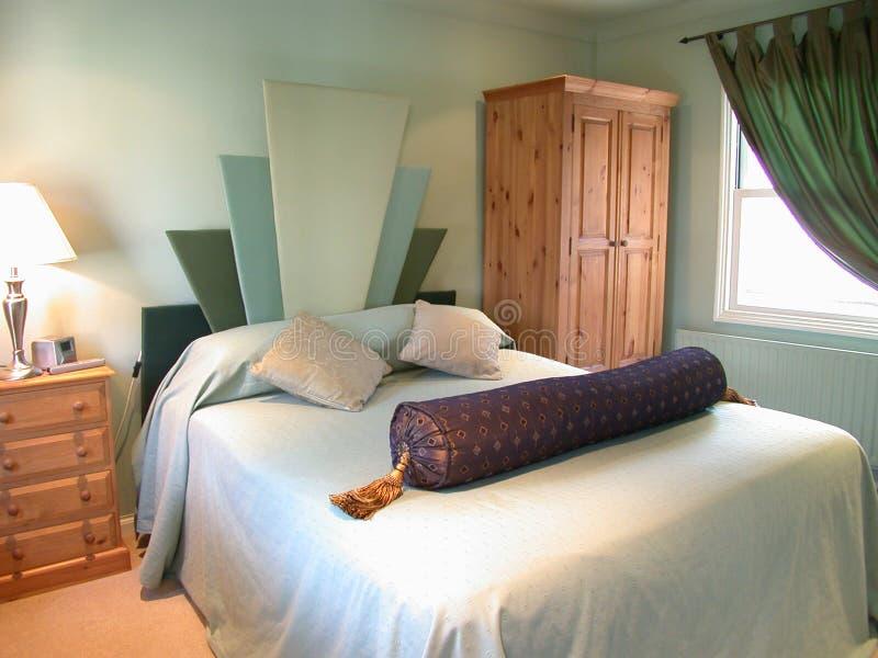 Grünes Schlafzimmer Lizenzfreie Stockfotografie