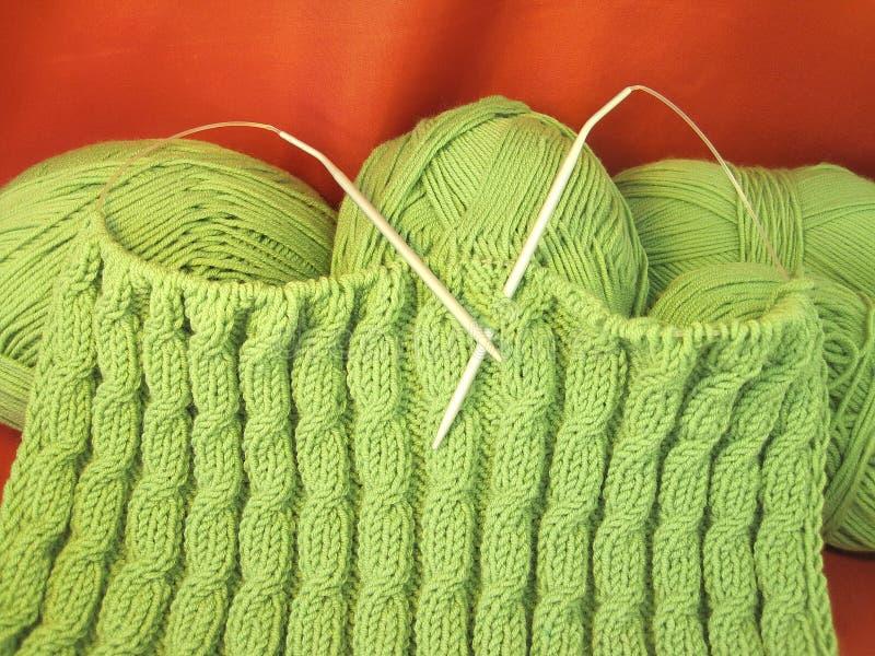 Grünes Stricken stockbild