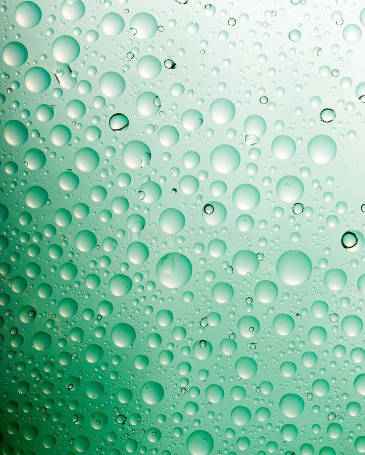 Grünes Wasser lässt background.close oben von fallen lizenzfreie stockfotografie