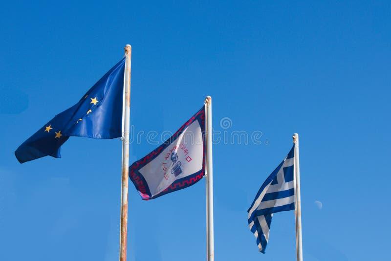 Gr?cia, a ilha do Ios Tr?s bandeiras fotografia de stock