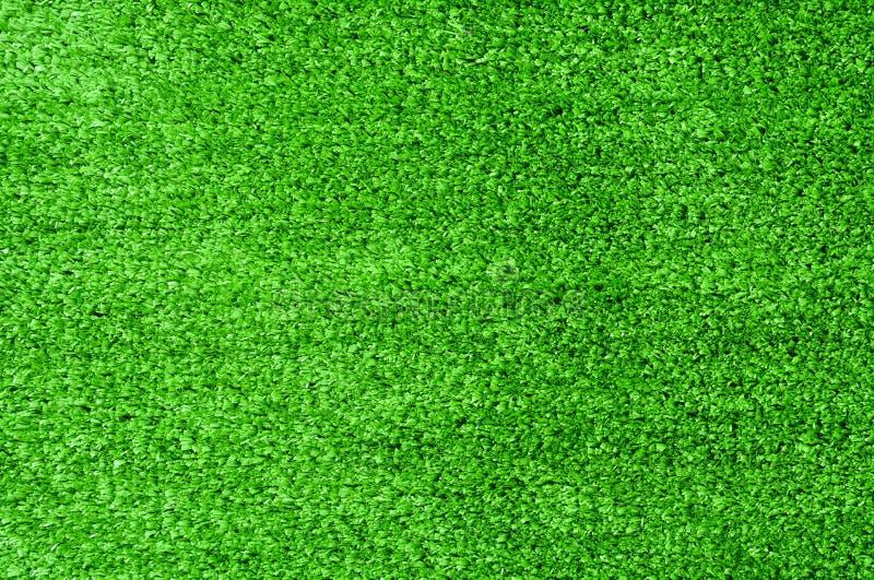 Gr?n konstgjord gr?stexturbakgrund royaltyfri fotografi