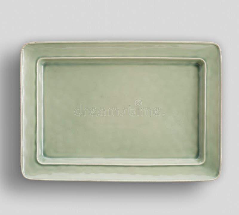 Gr? platta p? vit bakgrund - bild royaltyfria bilder