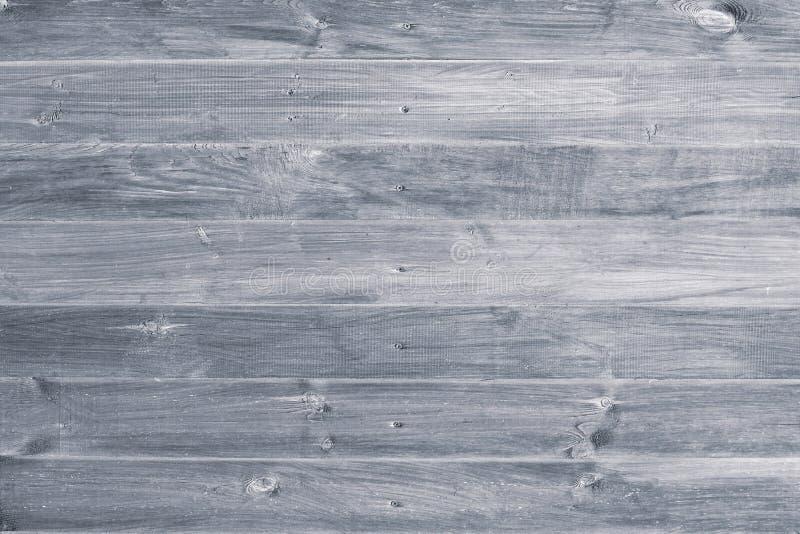 Gr? tr?bakgrund Gråa träbräden, smutsigt staket, plankor Ridit ut tappningyttersida, modell Horisontalband på sjaskigt p arkivbild