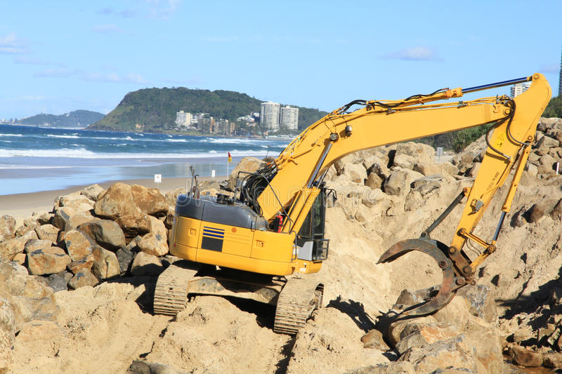 Download Grab Excavator. Boulder Wall Construction. Stock Photo - Image of machinery, ocean: 30964022
