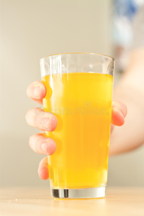 Grab a glass of OJ stock photography