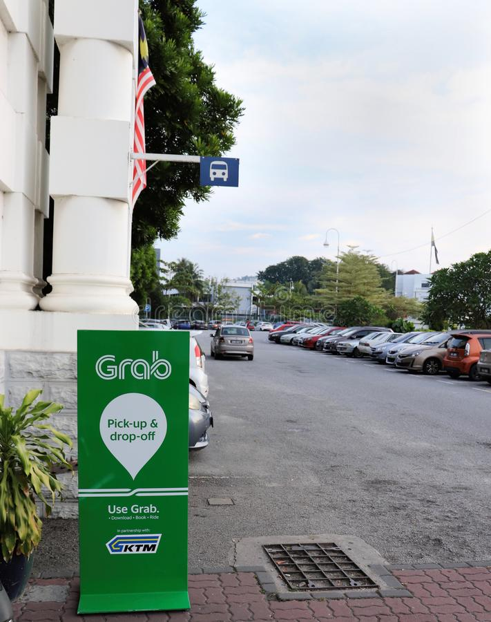 Grab`s Pick-up And Drop-off Sign At The Ipoh Railway Station. The pick-up and drop-off signboard of the leading ride-hailing company in Malaysia Grab at the Ipoh stock image