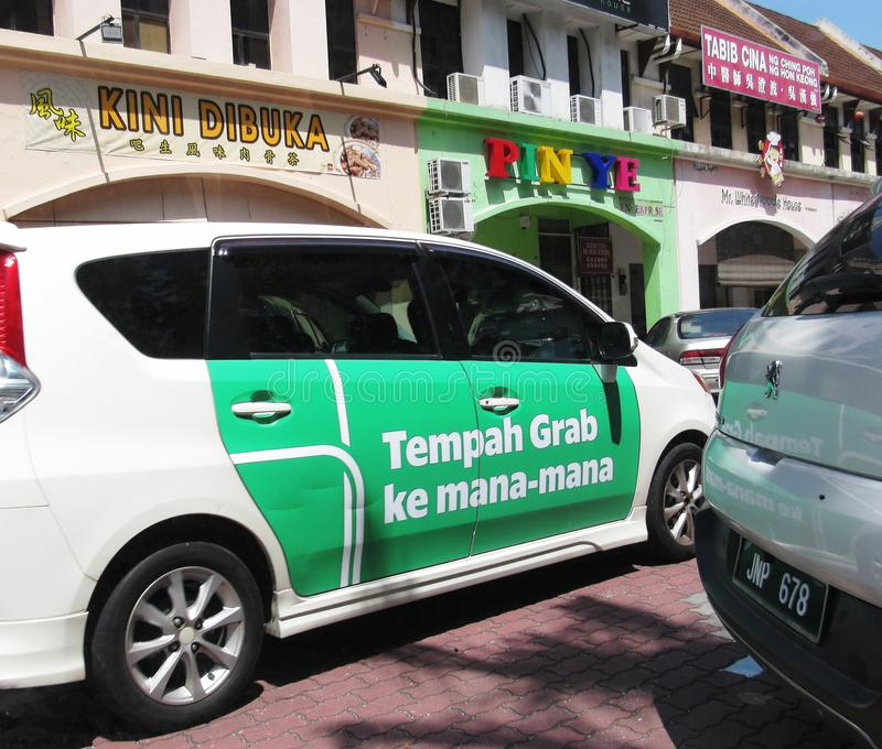 Grab Vehicle In The Streets Of Ipoh. The ride-hailing/ride-sharing service Grab roaming the streets of Ipoh, Malaysia royalty free stock images