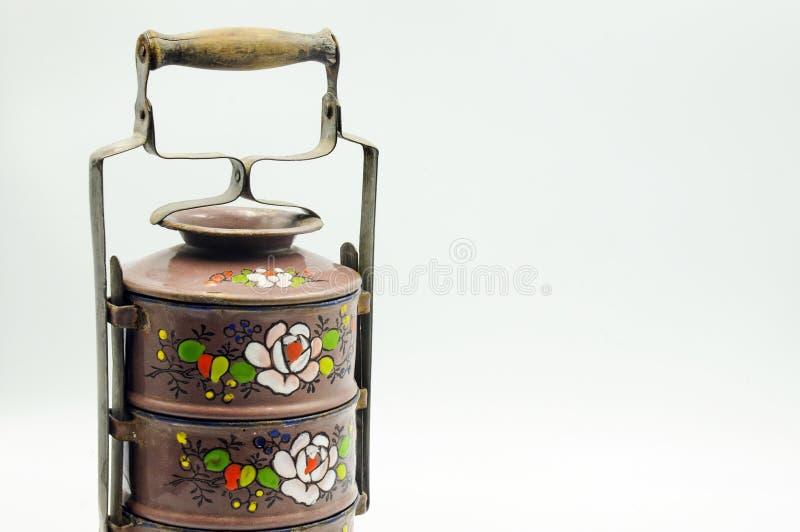 Grabado en relieve esmalte el portador de Tiffin con el estampado de plores imagen de archivo libre de regalías