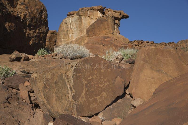 Grabados en Twyfelfontein, Namibia de la roca imagen de archivo libre de regalías