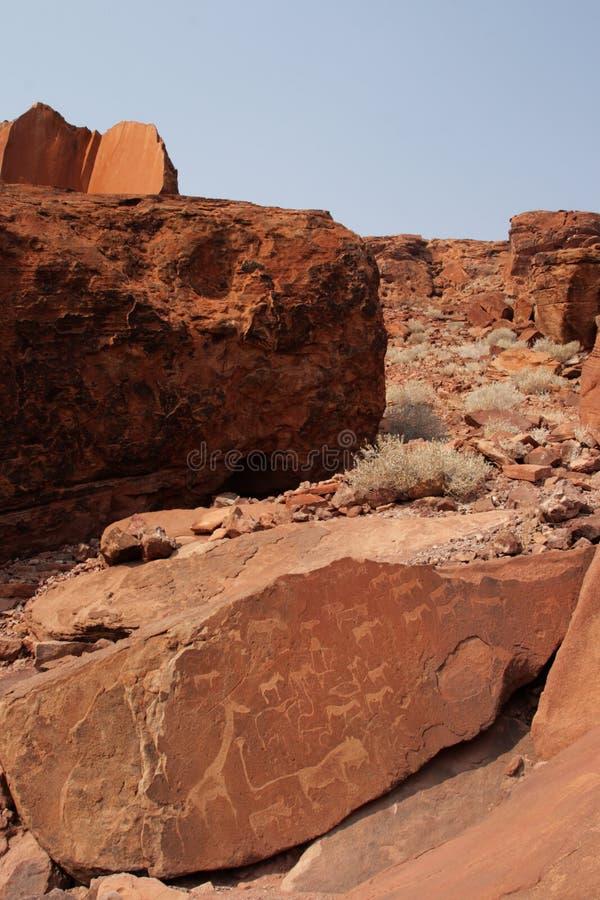 Grabados en Twyfelfontein, Namibia de la roca imagenes de archivo