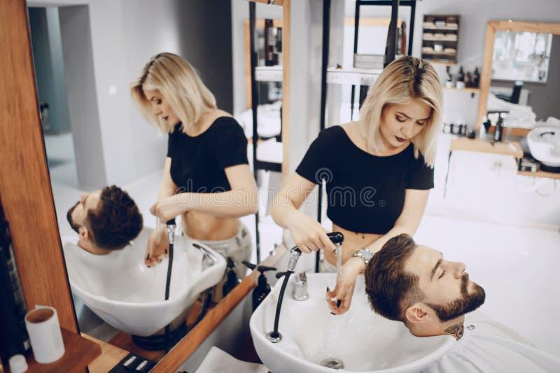 Grabb i barbercosna arkivfoto