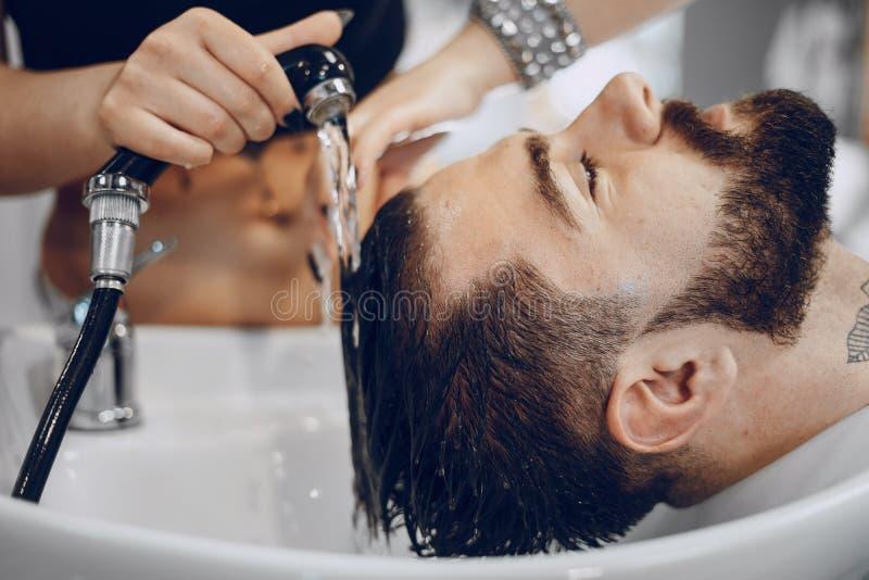 Grabb i barbercosna royaltyfri fotografi