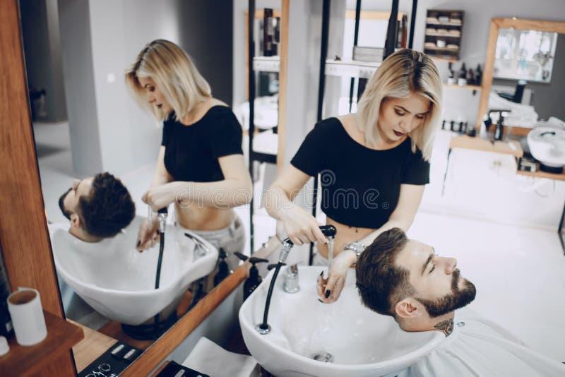 Grabb i barbercosna fotografering för bildbyråer