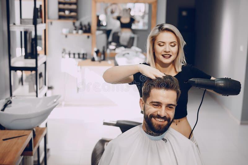 Grabb i barbercosna royaltyfria bilder