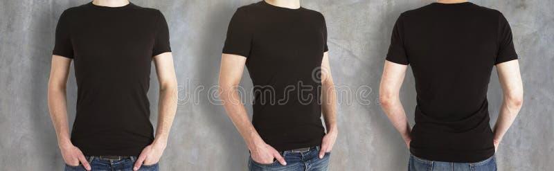 Grabbar som bär den tomma svarta skjortan royaltyfria bilder