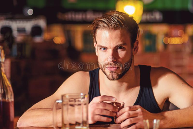 Grabbing a drink after work. Man drink strong alcoholic beverage and beer in pub. Alcoholic man drinking at bar counter. Alcohol addict with short alcohol stock photography