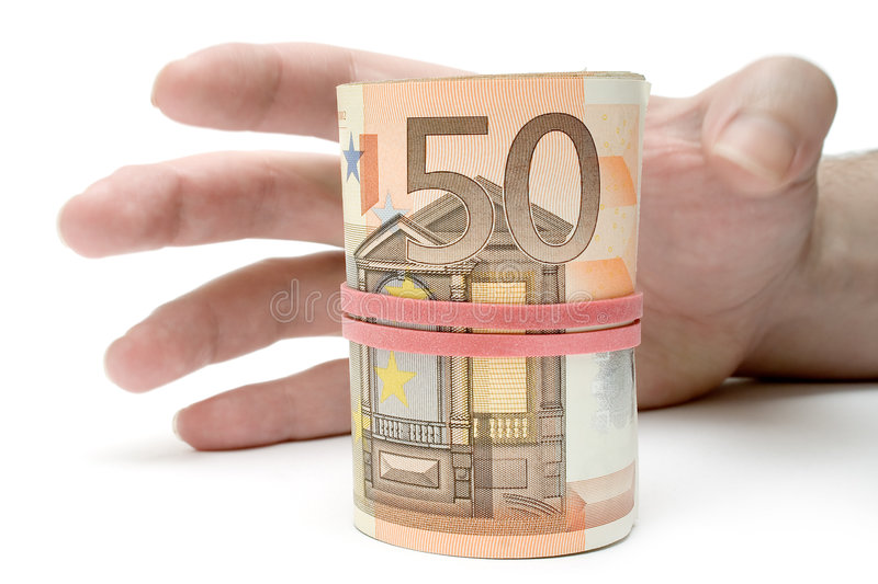 Grabbing a Roll of Money stock photography