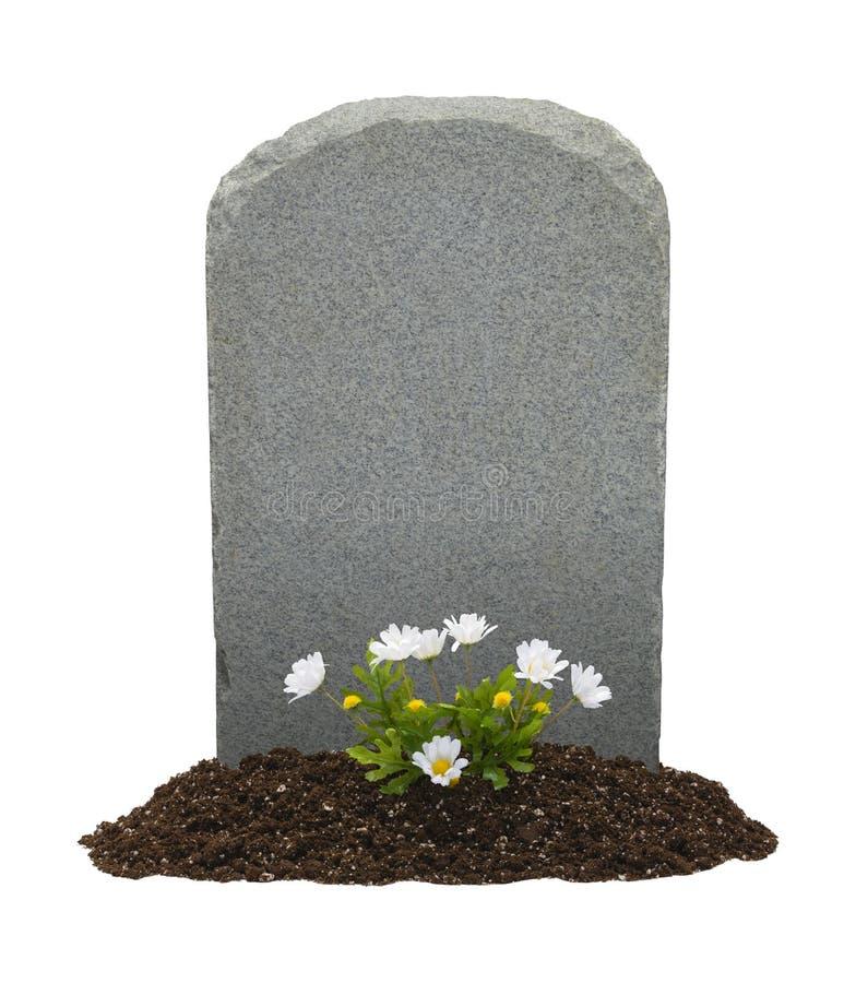 Grabstein und Blumen stockbild