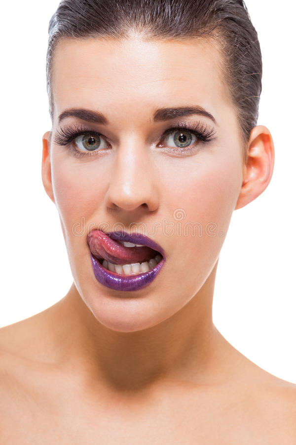 Graceful attractive woman with purple lips royalty free stock photo
