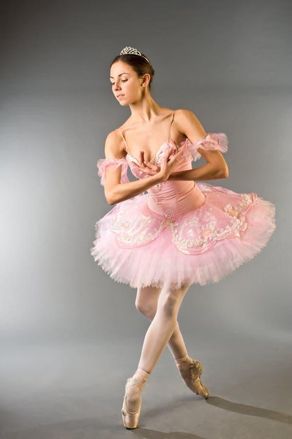 Graceful ballerina dancing isolated stock image