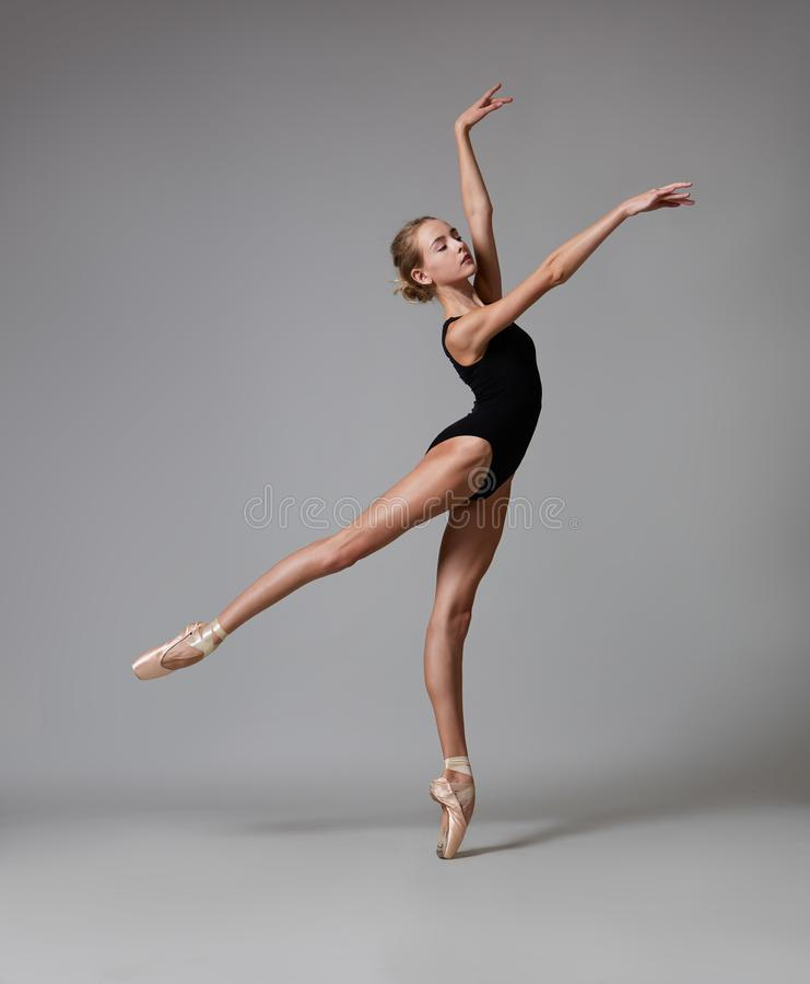 Graceful ballerina posing. Color photo. Graceful ballerina in pointe shoes and black lingerie posing. Color photo stock photo