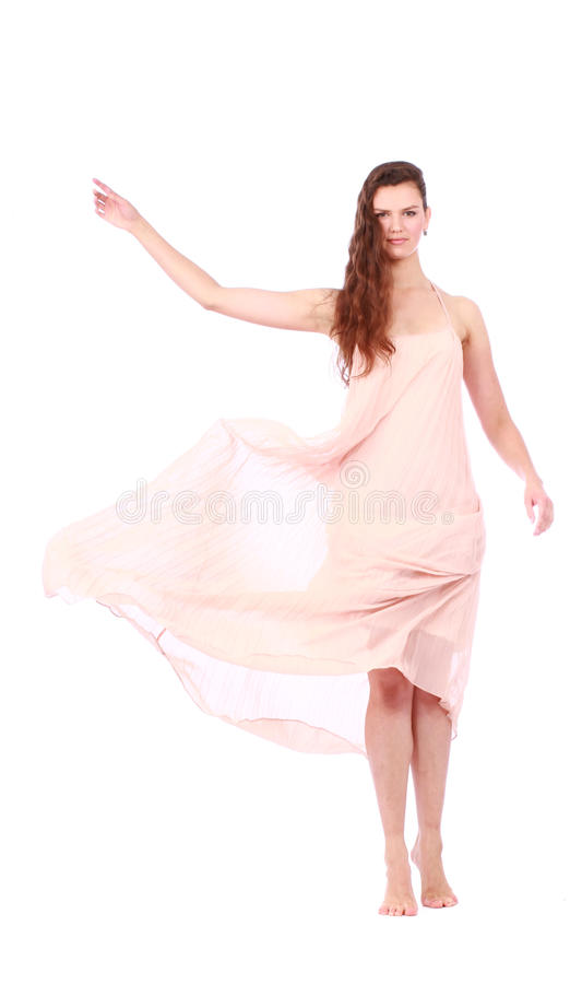 Graceful girl in flying light pink dress. Isolated on a white background royalty free stock photo