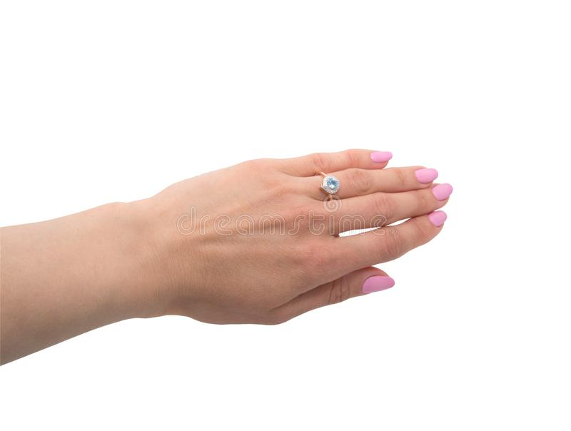 Graceful golden ring with topaz and few diamonds on woman`s han royalty free stock photo