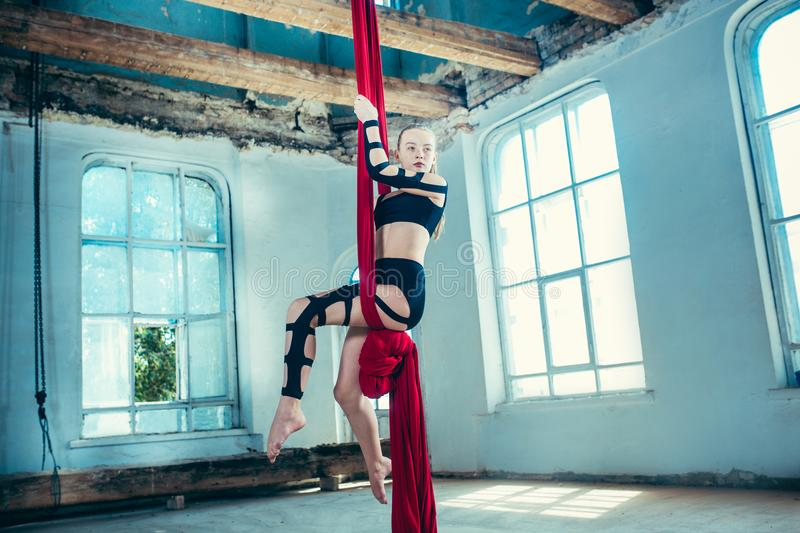 Graceful gymnast performing aerial exercise at loft stock photos