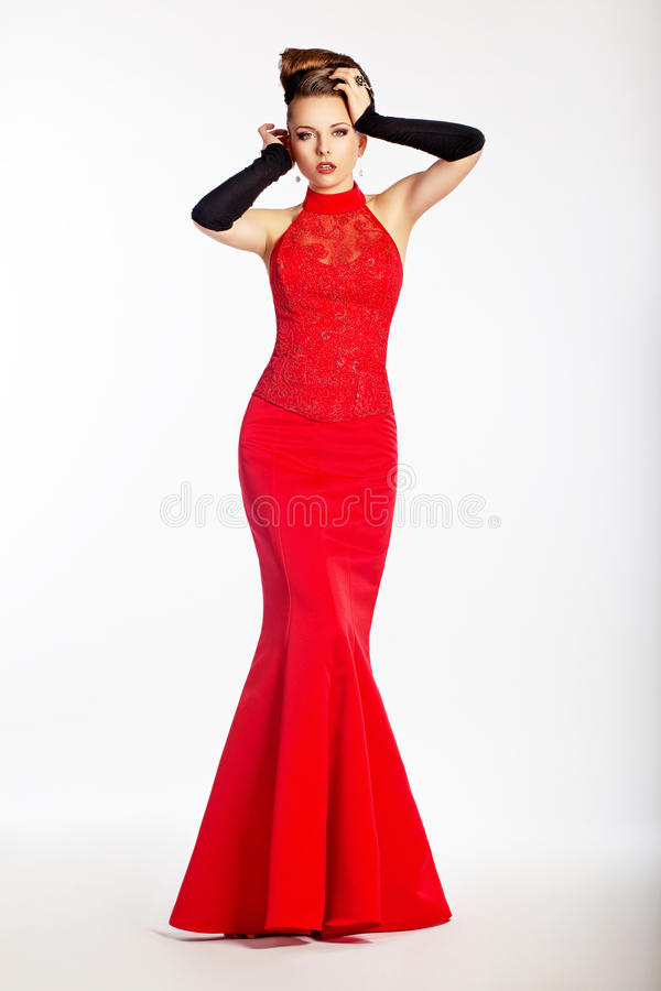 Graceful newlywed in red dress. Luxury