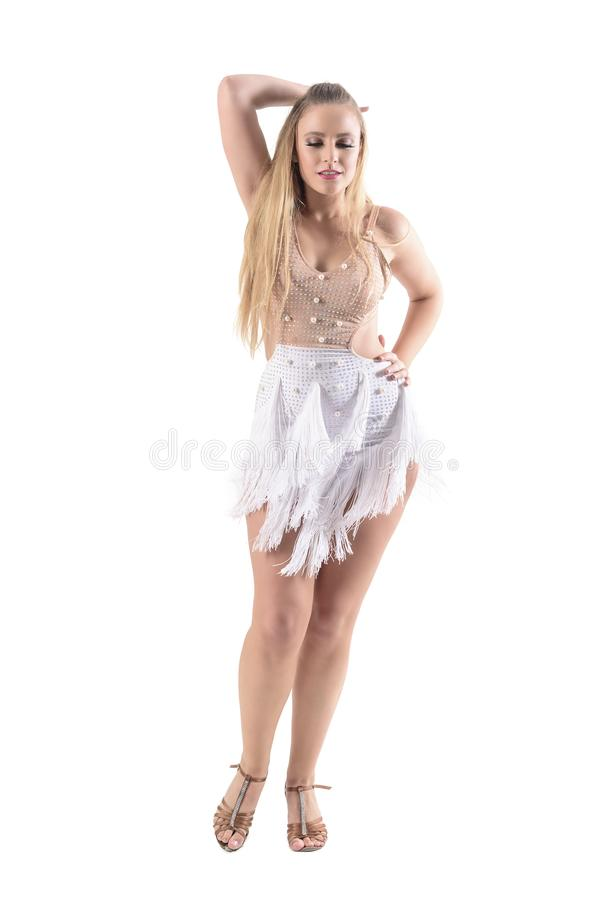 Graceful passionate elegant woman in dress dancing and looking down with hand in hair. stock photos