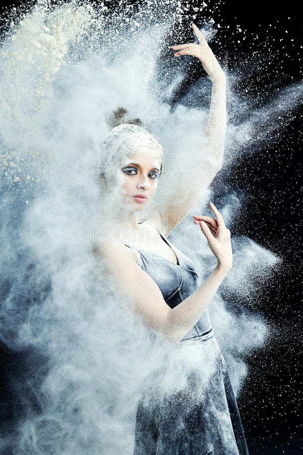 Graceful woman dancing in cloud of dust stock image