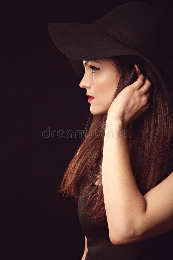 Graceful woman in elegant black hat with wide brim stock images