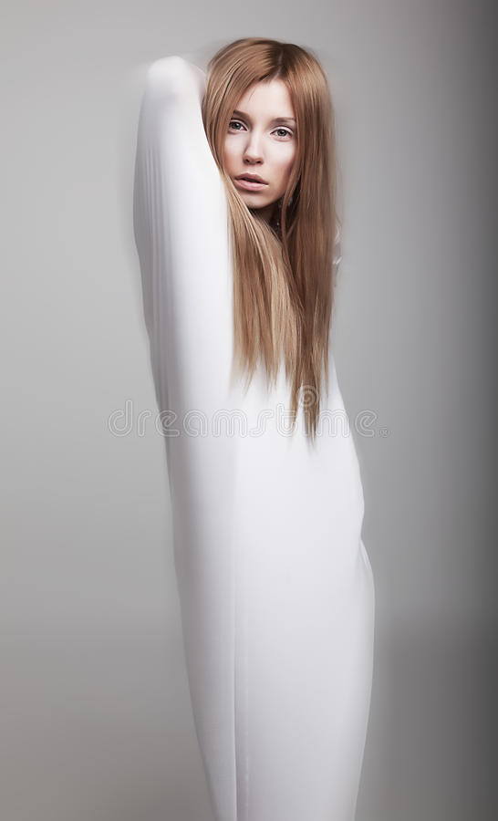 Graceful woman silhouette in white clothes. Graceful female vague silhouette in white clothes - studio shot stock photos