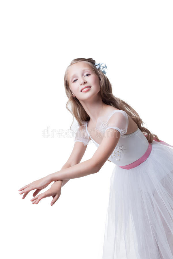Graceful young girl posing in dance at camera royalty free stock photos