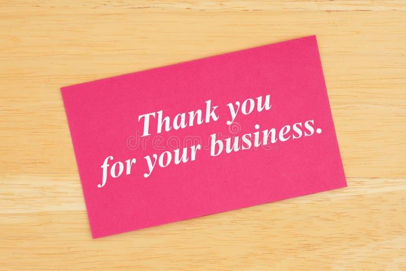 Gracias por su texto del negocio en tarjeta rosada foto de archivo