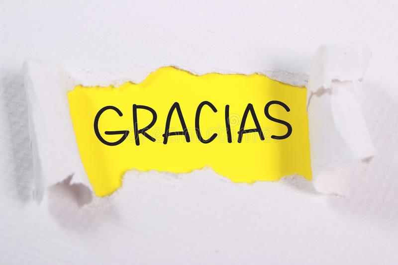 Gracias, Motivational Words Quotes Concept. Gracias Spanish thank you words letter, written on piece of memo paper. Motivational business typography quotes stock photo