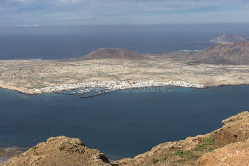 Graciosa Island, Canary Island. View from The Maridor del Rio on Graciosa Island and volcano , Lanzarote island. Canary Islands, Spain stock photos