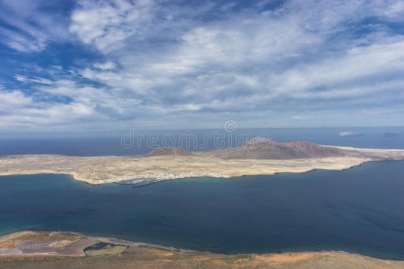 Graciosa Island, Canary Island. View from The Maridor del Rio on Graciosa Island and volcano , Lanzarote island. Canary Islands, Spain royalty free stock images