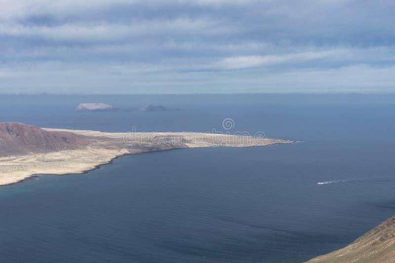 Graciosa Island, Canary Island. View from The Maridor del Rio on Graciosa Island and volcano , Lanzarote island. Canary Islands, Spain stock photo
