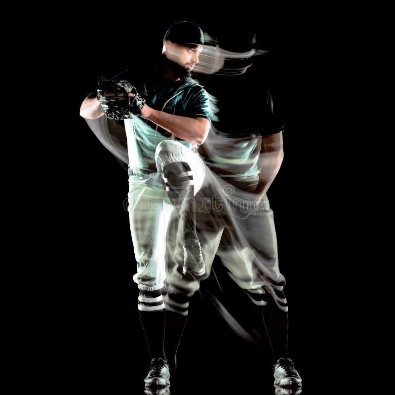 Gracz baseballa tła światła mężczyzna odizolowywający czarny obraz zdjęcia stock