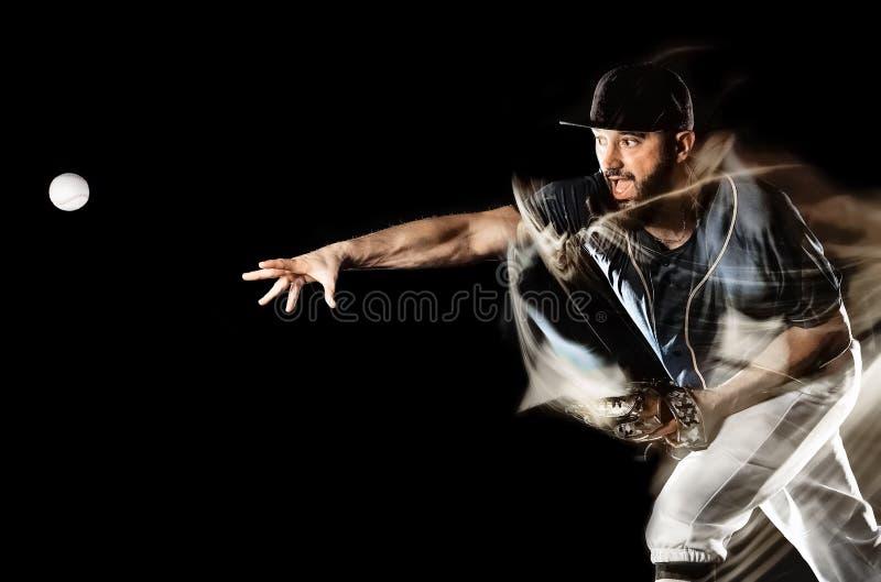 Gracz baseballa tła światła mężczyzna odizolowywający czarny obraz zdjęcie royalty free