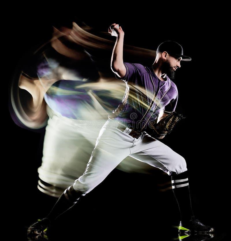 Gracz baseballa tła światła mężczyzna odizolowywający czarny obraz obrazy royalty free