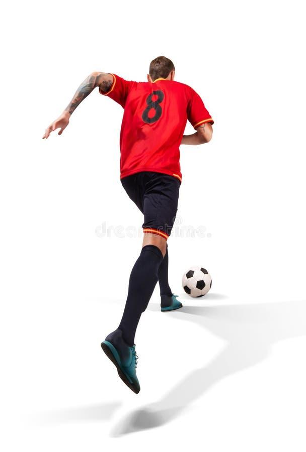 Gracz futbolu bieg z piłką odizolowywającą na bielu zdjęcie royalty free