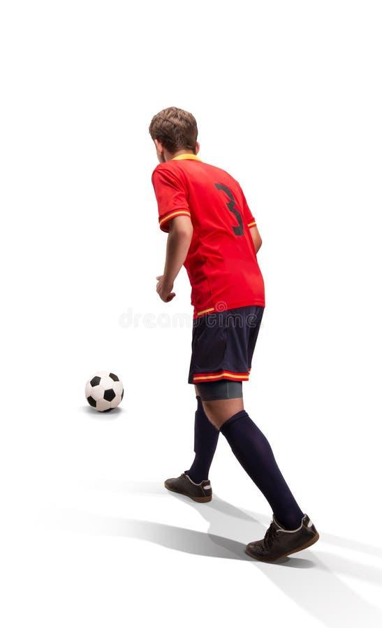 Gracz futbolu prepairing brać strzał odizolowywającego obraz royalty free