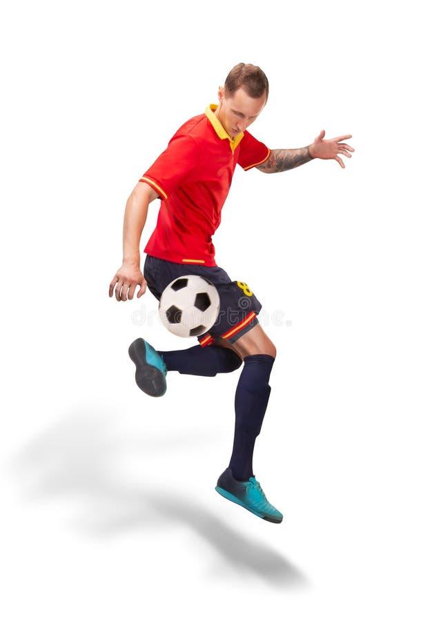 Gracz futbolu robi sztuczce odizolowywającej na bielu fotografia royalty free