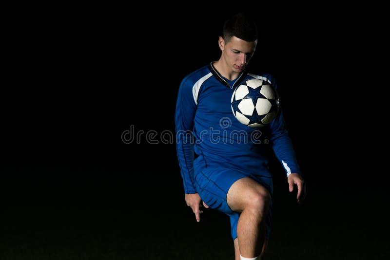 Gracz Futbolu Z piłką W akci zdjęcia royalty free