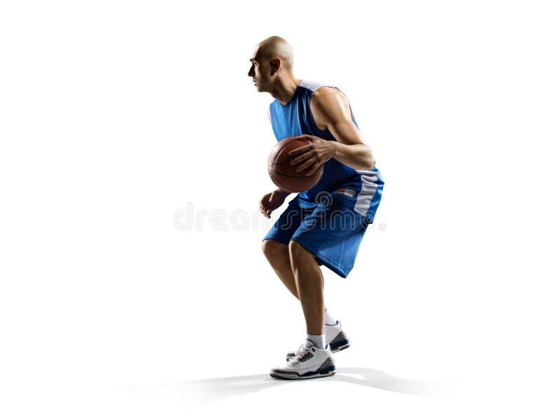 Gracz koszykówki w akci odizolowywającej na bielu zdjęcie stock